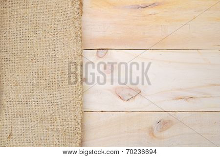 Gunny Sack Texture And Wood Plank Table Background