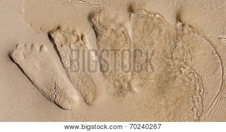 Footprints On Beach Were Dissolved By The Ocean Water