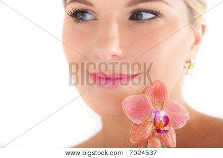 young beautiful healthy woman with pure skin and flower