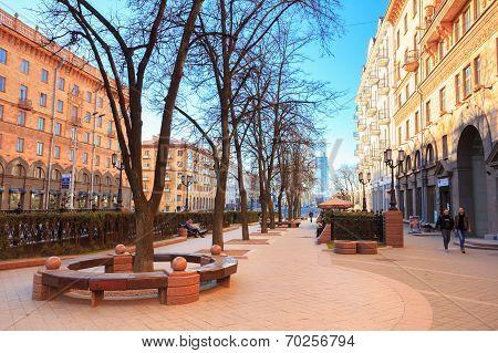 People Walking On The Sidewalk On Lenin Street In Spring In Minsk, Belarus.