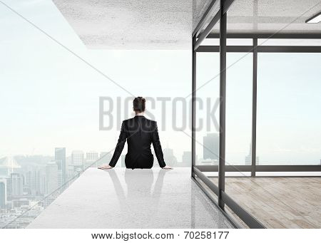 Businessman Sitting On Skyscrapper