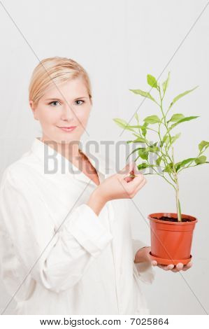 young female scientist botanic with green tree