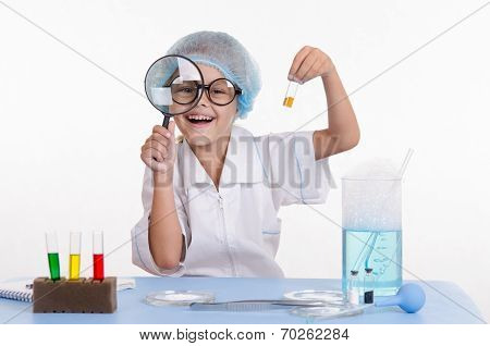 Chemist With The Powder And A Magnifying Glass