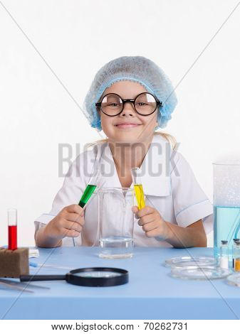 Young Chemist Mixes The Liquid
