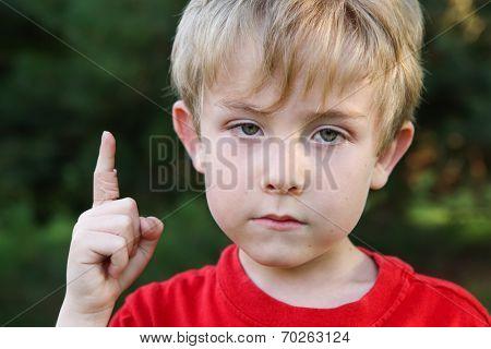 Sad boy with a bandaged finger