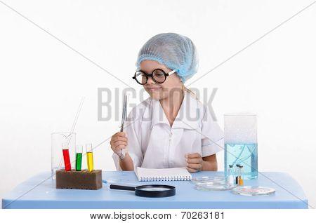 Girl Chemist Holding Tweezers