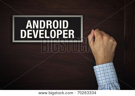 Businessman Knocking On Android Developer Door