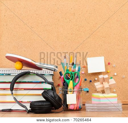 School Accessories On Desktop With Blank Pinboard In The Background