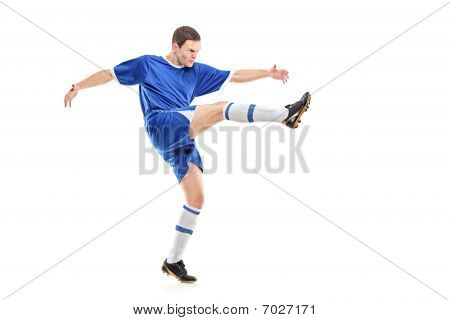 A soccer player shooting