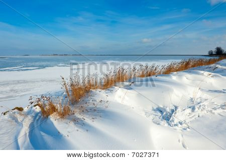 Snow Dunes At A Lake In Winter