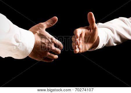 Businessmen About To Shake Hands