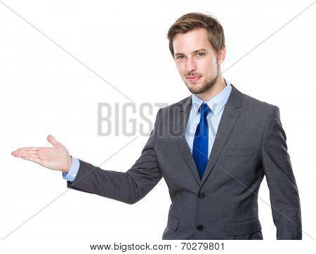 Caucasian businessman with hand presentation
