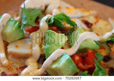 Tomatoes and avocado flatbread