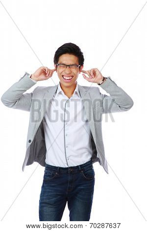 Portrait of man holding hands to ears covering to shut out noise