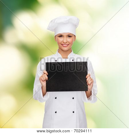 cooking, advertisement and food concept - smiling female chef, cook or baker with blank black paper