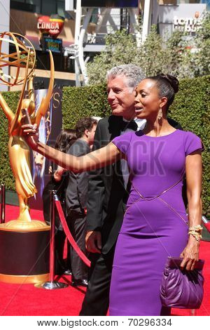 LOS ANGELES - AUG 16:  Anthony Bourdain, Aisha Tyler at the 2014 Creative Emmy Awards - Arrivals at Nokia Theater on August 16, 2014 in Los Angeles, CA