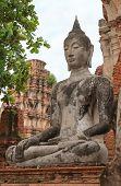 stock photo of mudra  - Old Buddha statue in meditate bhumisparsha mudra posture at Wat Mahathat Ayutthaya Thailand - JPG