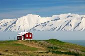 stock photo of iceland farm  - Iceland summer landscape in Fjord house mountains - JPG