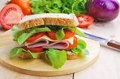 stock photo of smoked ham  - Club Sandwich with Cheese Tomato and ham - JPG
