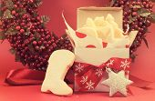 stock photo of shortbread  - Christmas gift box of shortbread biscuit cookies with festive ornament decorations left out for Santa with retro vintage filter - JPG