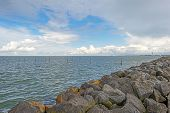 pic of dike  - Clouds over a dike in a lake - JPG