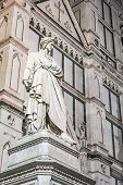 picture of alighieri  - statue of italian poet Dante in front of Santa Croce cathedral in Florence Italy