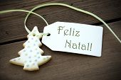 picture of natal  - A Christmas Tree Cookie with a Label with the Portuguese Words Feliz Natal on it which means Merry Christmas - JPG