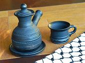 image of loamy  - Ceramic coffeepot and cup on a table - JPG
