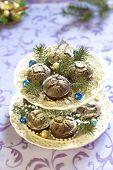 stock photo of desert christmas  - Homemade Christmas chocolate cakes with powdered sugar - JPG