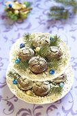 foto of desert christmas  - Homemade Christmas chocolate cakes with powdered sugar - JPG