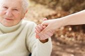 picture of grandmother  - Elderly woman holding hands with young woman outside - JPG