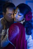 pic of ceremonial clothing  - an Indian couple dressed in traditional Indian clothing - JPG