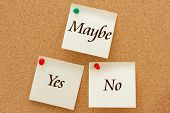 image of yes  - Yes No and Maybe Three yellow sticky notes on a cork board with the words Yes No and Maybe - JPG