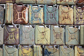 stock photo of petrol  - detail of old brown rusty petrol cans - JPG