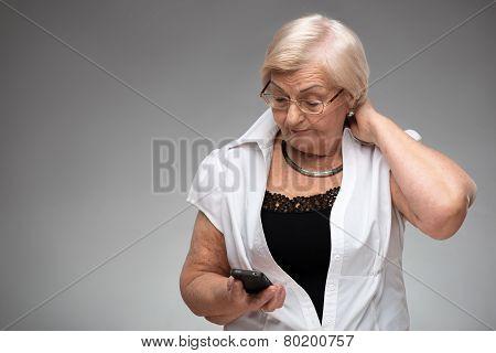 Elderly woman holding smartphone