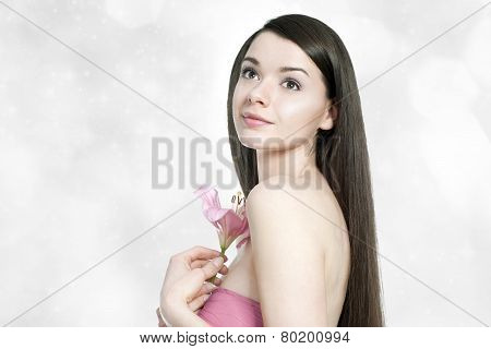 Beautiful Young Brunette Woman With Pink Lilly