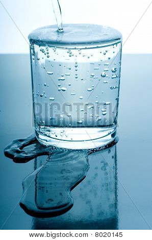 Overflowed Glass Of Water