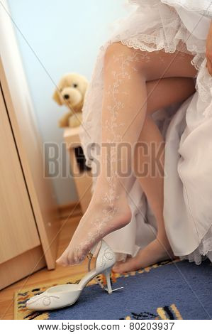 Bride Puts On Shoe