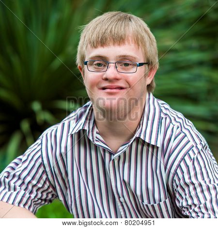 Portrait Of Handicapped Boy Wearing Glasses.