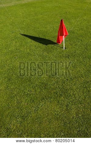 red flag on green grass