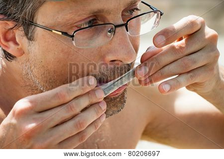 Man Rolling Hashish Joint