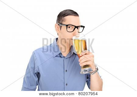 Young guy drinking a pint of beer isolated on white background