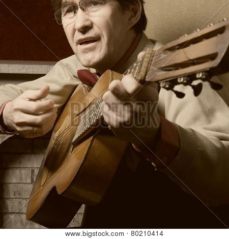 Bard Man In Glasses Playing Guitar.