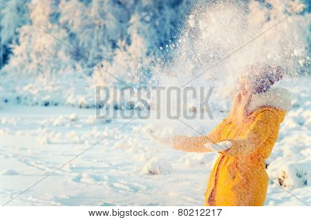 Young Woman playing with snow Outdoor Winter Lifestyle