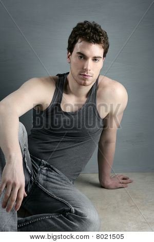 Casual Young Man Portrait Sit Over Gray