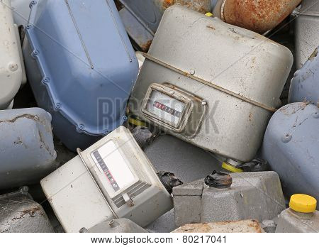 Disused Gas Meters In A Landfill Of Toxic Waste