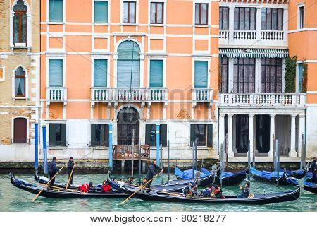 Gondolas With Tourists In Venice