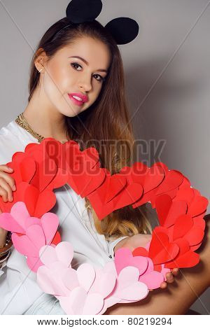Beautiful woman with symbol Valentine's day in his hands.