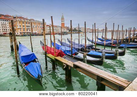 Moored Gondolas At Dock In Venice