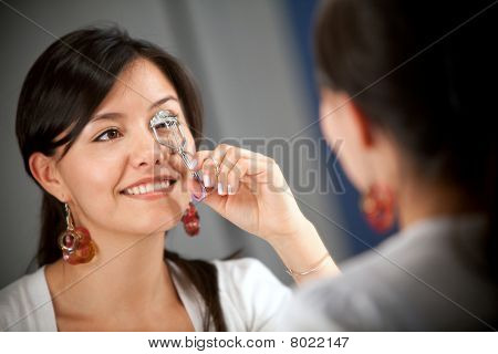Woman Curling Her Eyelashes